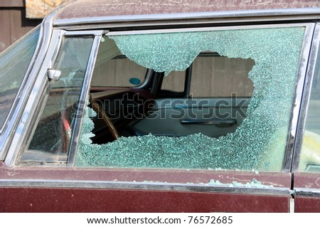 Old Dirty Car with Busted Window - stock photo