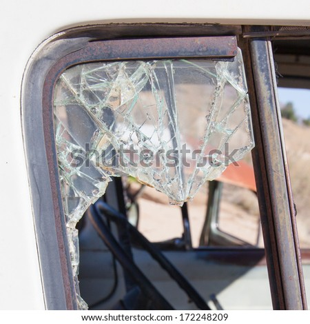 Old dirty car with busted window, Namibia - stock photo