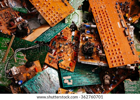 Old dirty electronic boards thrown in the trash. - stock photo