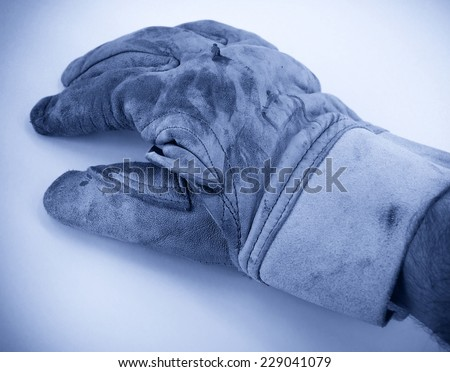 Old dirty leather work gloves  - stock photo