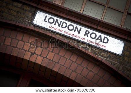 Old dirty London Road sign in London, England