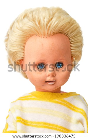Old dirty plastic doll isolated on white background - stock photo