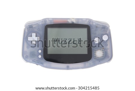 Old dirty portable game console with a small screen - puzzle - stock photo