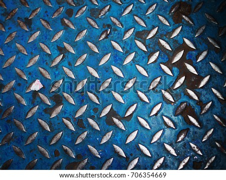 old dirty rusty deep blue iron bar checker plate non slip pattern tile floor background of