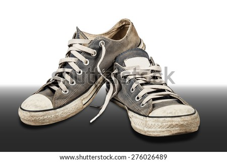 Old & dirty shoes - stock photo