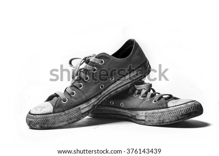 Old & dirty shoes isolated on white background