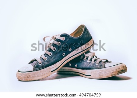 Old & dirty shoes isolated on white background retro photogrphy coloring