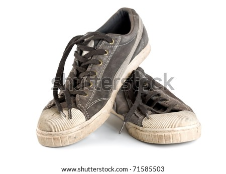 Old dirty sneakers isolated on white background - stock photo