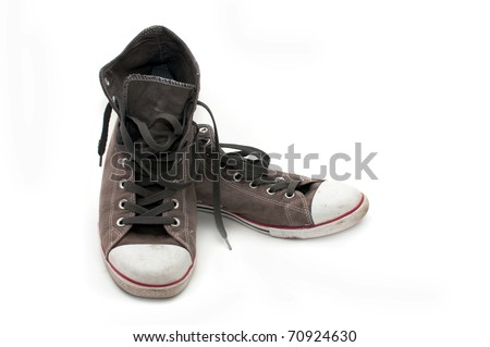 Old dirty sneakers over white background