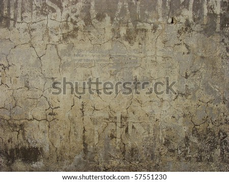 old dirty worn wall with old advertising fonts still showing - stock photo