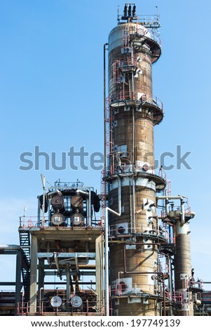 Old distillation tower - stock photo