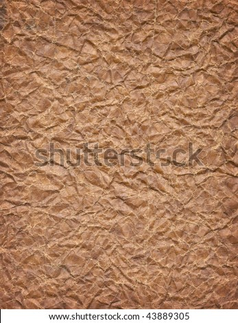 Old, distressed, very wrinkled paper - stock photo