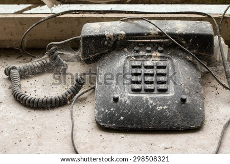 old disused phone overgrown with cobwebs - stock photo