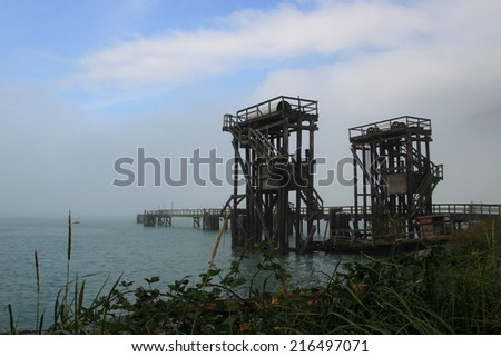 Old docks on the Squamish Oceanfront Interpretive Trail. The area was once a large industrial zone which has been restored. - stock photo