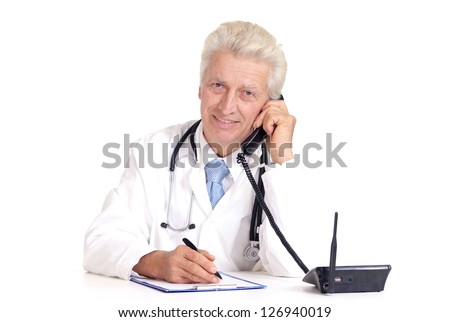 old doctor writing on a white background - stock photo