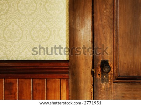 Old door and wallpaper - stock photo