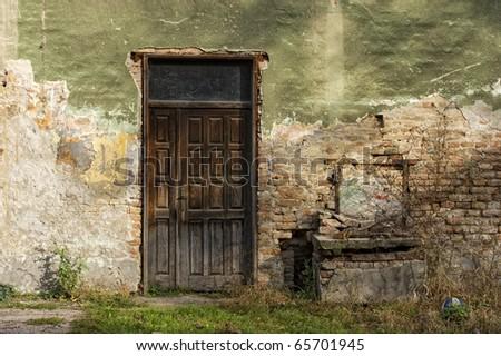 old door and window of brick building - stock photo