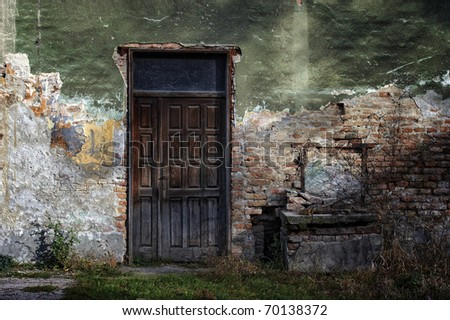 old door and window of brick building - stock photo