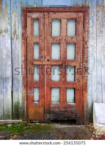 Old door. Blue wall. - stock photo