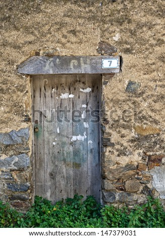Old door fragment with wall background, old door texture view, abstract scene, old pattern abstract, close up, object close up view, old building fragment, nobody lives, closed door view - stock photo