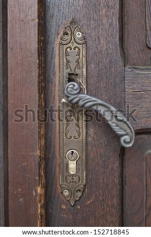 Old Door handle closeup on old brown door backround - stock photo