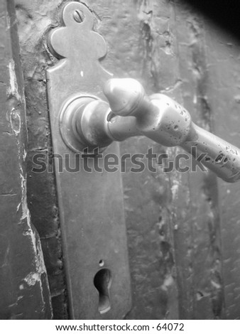 Old door handler in Trondheim, Norway. - stock photo