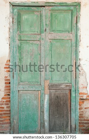 Old door in a crumbling building - stock photo