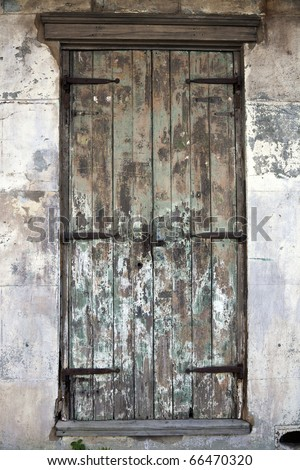 Old Door in French Quarter of New Orleans. - stock photo
