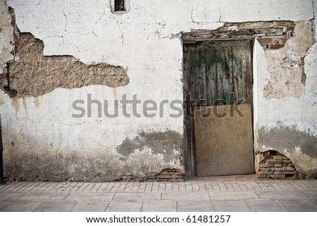 Old door in old street of shops - stock photo