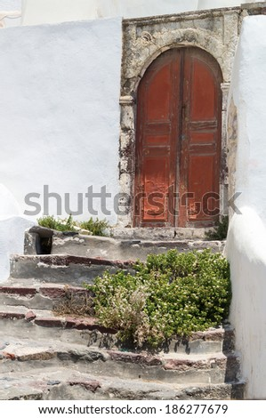 Old door in santorini Greece - stock photo