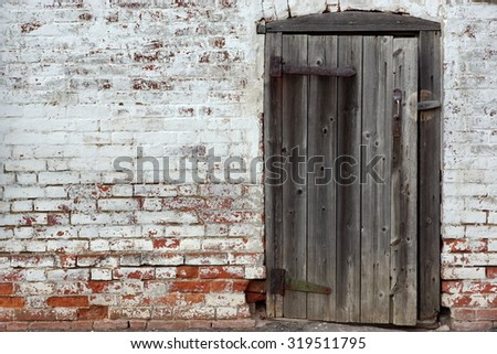 Old Door In The Rustic Retro Wall Background - stock photo