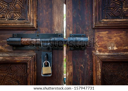 old door lock with key - stock photo