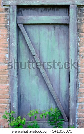Old door of old house - stock photo
