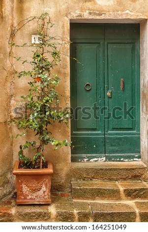 Old door of Tuscany italy - stock photo