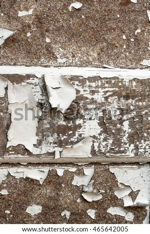 Old door .  Old paint on a board . Old wooden texture background