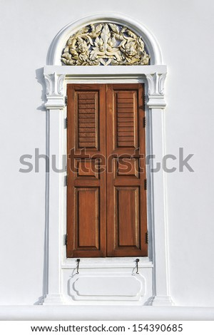 Old door on a cement wall. - stock photo
