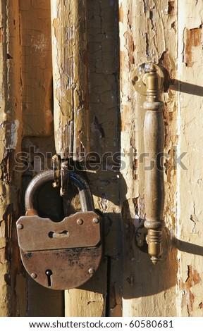 Old door rusty lock  and  handle - stock photo