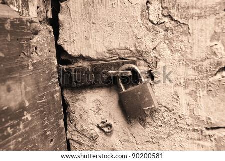 old door shut with a padlock - stock photo