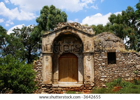 Old door under Akropolis in Athens, Greece