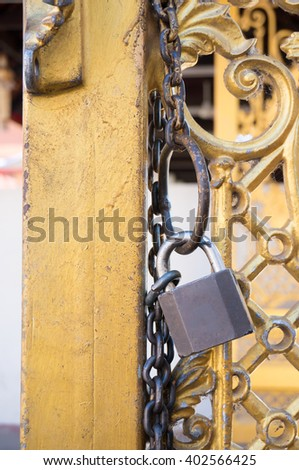 old door with lock and chain - stock photo