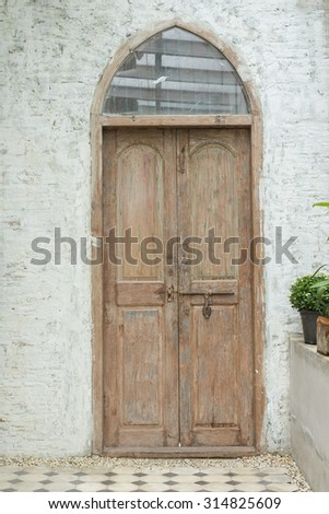 old door with old cement wall - stock photo