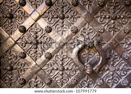 Old door with ornament in stone wall in Royal Wawel Castle, Cracow, Poland. - stock photo