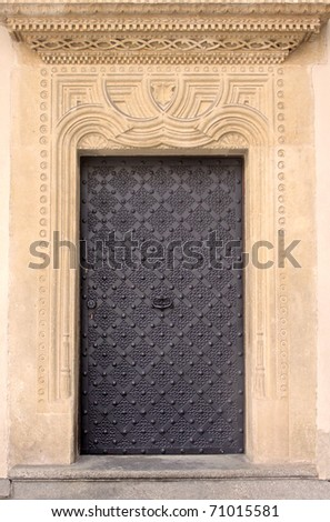 Old door with ornament in stone wall. Royal Wawel Castle, Cracow. Poland - stock photo