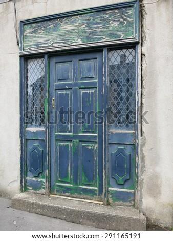Old door with peeling paint in blue and green, Killala, County Mayo, Ireland, June 2015                  - stock photo