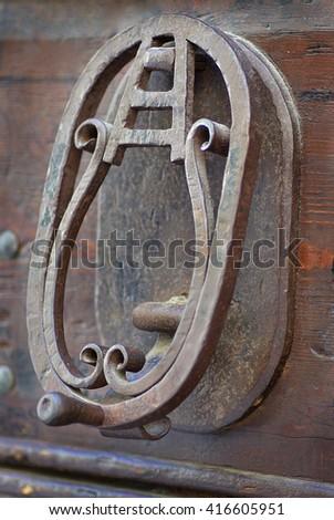 Old doorknocker - stock photo