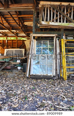 old doors and windows in a junk pile - stock photo