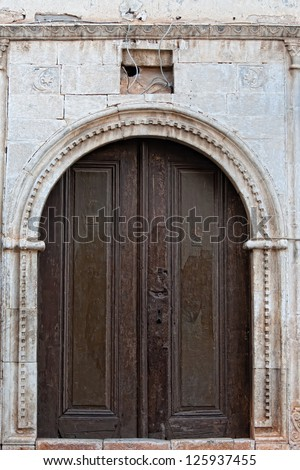 Old doors in a stone wall in Turkey - stock photo