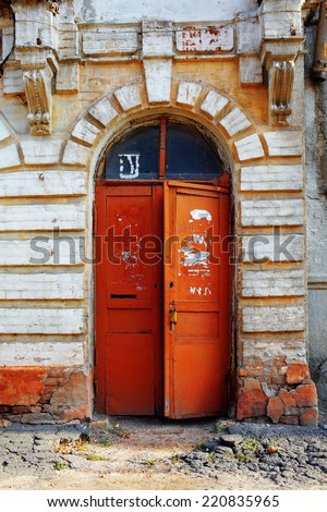 old doors in the house from time to time grown old - stock photo