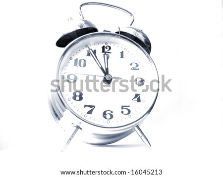 Old double bell alarm clock isolated on a white background with blue tone. Shallow DOF. A concept of time. - stock photo