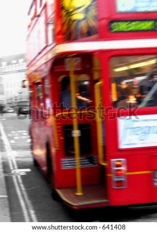 Old doubledecker in motion - stock photo